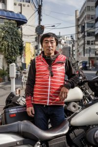 Tokyo, November 7 2015 - Shin Ikeda, editor in chief of Japanese Hot Bike Magazine during a photoshooting in the Harajuku area.