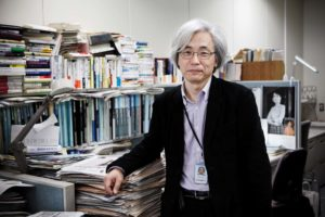 Tokyo, February 8 2012 - In the headquarters of the Asahi Shimbun, the second most circulated out of the five national newspapers in Japan. Portrait of Hirohito Ohno, senior staff writer and ex-correspondent of the newspaper in France, in front of his desk.