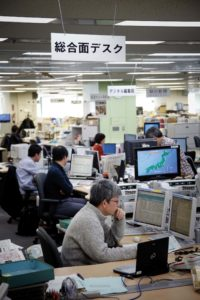 Tokyo, February 8 2012 - In the headquarters of the Asahi Shimbun, the second most circulated out of the five national newspapers in Japan. Journalists working in the main editing room.
