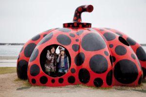 Naoshima, November 28 2011 - Red pumpkin by Japanese artist Yayoi Kusama in the harbour of Naoshima.