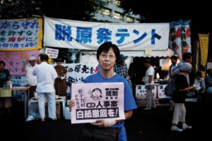 Tokyo, August 31st 2012 - Portrait of Mie Anthearn in front of the anti-nuke tents in Kasumigaseki.