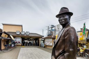 Tokyo, March 10 2015 - Shibamata, in the footsteps of Tora-san and Yoji Yamada. Statue of Tora-san at the exit of the station.