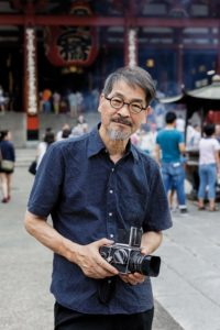 Tokyo, July 28 2015 - Portrait of Japanese photographer Hiroh Kikai in Asakusa's Senso-ji, where he took his famous black and white portraits.
