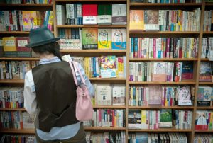 Tokyo - Junkudo bookshop - A young japanese girl reading 1Q84, Haruki Murakami's latest novel. The book was a bestseller before it arrives in the bookshops. More than one million copies were sold two weeks after its release.