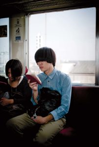 Tokyo, October 15 2010 - Reading on the train.