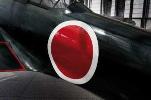 Tokyo, April 10 2014 - In the entrance of the Yushukan, Yasukuni's war museum, a A6M Zero fighter aircraft on display.