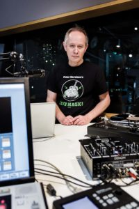 Tokyo, December 14 2014 - Portrait of Peter Barakan, DJ and broadcaster, at InterFM Radio before his Sunday evening show.