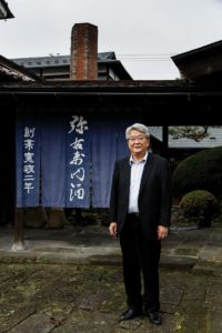 Kitakata, Fukushima prefecture, November 19 2013 - Mr SATO, president of Yauemon distillery posing in front of the museum.