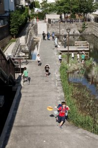 Tokyo, May 17 2013 - Kids playing near a canal of Koto ward area.