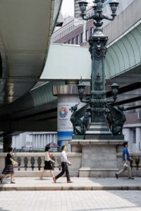 Tokyo, July 2013 - The Nihonbashi bridge first became famous during the 17th century, when it was the eastern terminus of the Nakasend? and the T?kaid?, roads which ran between Edo and Kyoto. Shortly before the 1964 Summer Olympics, an expressway was built over the Nihonbashi bridge, obscuring the classic view of Mount Fuji from the bridge. In recent years, local citizens have petitioned the government to move this expressway underground.