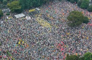 An aerial view from Kyodo shows people attending an anti-nuclear rally at Meiji Park in Tokyo September 19, 2011. Some 60,000 protesters from across Japan including a Nobel-prize-winning author Kenzaburo Oe, gathered in central Tokyo for an anti-nuclear rally on Monday, urging the Japanese government to cut reliance on atomic power. Mandatory Credit REUTERS/Kyodo (JAPAN - Tags: DISASTER ENERGY) FOR EDITORIAL USE ONLY. NOT FOR SALE FOR MARKETING OR ADVERTISING CAMPAIGNS. THIS IMAGE HAS BEEN SUPPLIED BY A THIRD PARTY. IT IS DISTRIBUTED, EXACTLY AS RECEIVED BY REUTERS, AS A SERVICE TO CLIENTS. MANDATORY CREDIT. JAPAN OUT. NO COMMERCIAL OR EDITORIAL SALES IN JAPAN. YES
