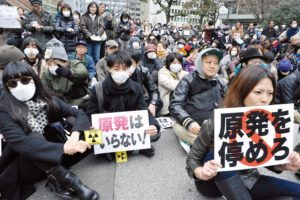 "Demonstration in central district Ginza against nuclear plants..Demonstrations are rare in Japan but a few hundreds of people gathered on Sunday 27th to protest against nuclear energy.. .On the placard: ""Stop the nuclear plants"".End of the demonstration in Hibiya park, central Tokyo"