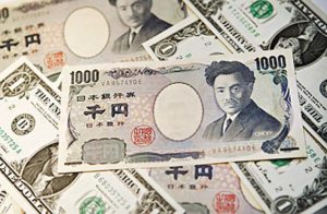 Image #: 4612392 A 1000 yen note is arranged on top of U.S. one dollar notes in New York, U.S., on Friday, March 7, 2008. The dollar fell to the weakest in three years against the yen and to a record low versus the euro on speculation the U.S. jobless rate rose and the Federal Reserve will cut its main interest rate by as much as 100 basis points this month. Photographer: Andrew Harrer/Bloomberg News /Landov